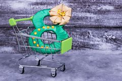Figure of eight in shopping trolley. Green number in shopping trolley. Shopping for Mother`s Day Royalty Free Stock Photos