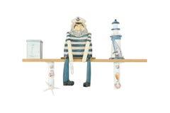 Figure en bois d'homme ou de Captian de Salior d'isolement sur le blanc Photographie stock libre de droits
