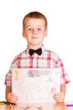 Figure en la mano del muchacho lindo aislada en blanco imágenes de archivo libres de regalías