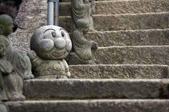 Figure en pierre heureuse Image libre de droits