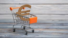 Concept euro money symbol in a shopping trolley Stock Images