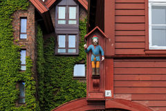 The figure on the facade of the old house Stock Photo