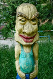 Figure fantastic character of wood with a big head on the playground Royalty Free Stock Photo