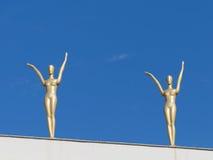 Figure femminili dorate Immagine Stock