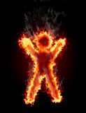 Figure in the fire. Human figure burns on the black background Stock Image