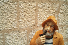 Figure of a fisherman Royalty Free Stock Image