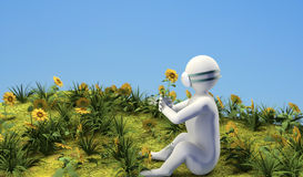 Figure with flower. And mask sitting on the ground Stock Photo