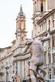 Figure of Fontana del Nettuno on Piazza Navona. Travel to Italy - figure of Fontana del Nettuno Fountain of Neptune and Sant Agnese in Agone Church on Piazza stock photography