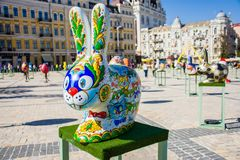 The figure of funny colored Easter bunny with big eyes and nose with painted cats on body. Beautiful Easter decoration art. Kyiv K. Iev, Ukraine stock photos