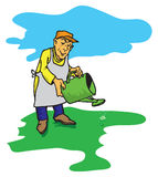 Figure gardener. Figure male gardener who waters the green lawn Royalty Free Stock Image