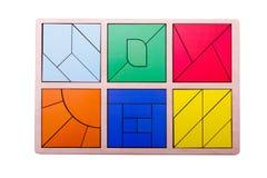 Figure geometriche variopinte educative Giocattoli di legno ecologici per il concetto dei bambini isolati su un fondo bianco Fotografia Stock Libera da Diritti