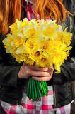Figure girl with bouquet of daffodils in his hands Royalty Free Stock Photos