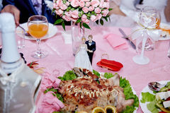 Figure of the groom with the bride on a holiday table Royalty Free Stock Images