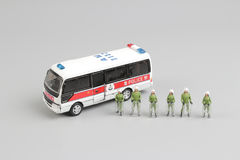 Figure of group police stand before the van Stock Photos