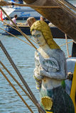 Figure head in the shape of a woman on the front side of a sailing vessel Stock Photo