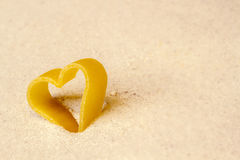 Figure of a heart in the sand Stock Images