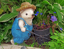 Figure of a hedgehog-gardener with hat and with trolley Royalty Free Stock Photos