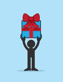 Figure Holding Gift. Figure holding up large gift with bow Royalty Free Stock Photography