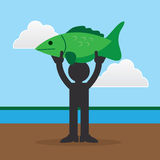 Figure Holding Large Fish. Silhouette figure holding up a large fish Stock Photos