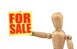 Figure holding a sale announcement Royalty Free Stock Photo