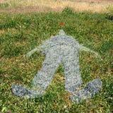 Figure humaine imprimée sur l'herbe Photo stock