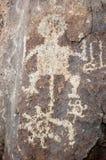 Figure humaine spiralée pétroglyphe Image libre de droits