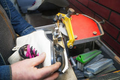 Figure ice skate getting sharpened royalty free stock images