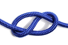 Figure-ight knot. Figure-eight knot made with blue rope on white background Stock Photos