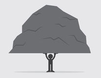 Figure Lifting Large Rock. Silhouetted figure lifting a large heavy rock Royalty Free Stock Photography