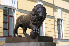 The figure of a lion on a pedestal. The figure of a lion on a pedestal Stock Images