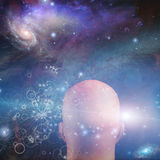 Figure looks into space. Cosmic and particle Royalty Free Stock Photo