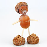 Figure made of acorns and matches Royalty Free Stock Photo