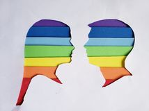 Figure of male and female human faces of profile with the colors of the rainbow and the white background. Backdrop for colors ads, lgbt community and diversity royalty free stock photos