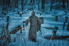 Figure man from back with  scythe of death. Royalty Free Stock Photos