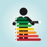 Figure man holds simple energy label Stock Photo