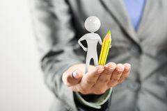 Figure of man with pencil stands on woman's hand. Figure of man with yellow pencil stands on woman's hand Stock Images
