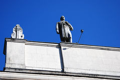 Figure of a man on the roof top. Stock Photo