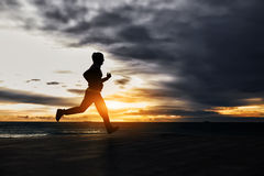 Figure of a man running at sunset Royalty Free Stock Images