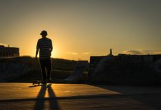 Late day skateboarding at a skate park stock photos