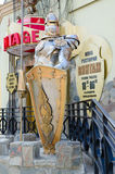 Figure of medieval knight in armor at entrance to restaurant Stock Photo