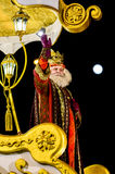 Figure of Melchior during parade. Melchior, one of the three Magi, seen here in a golden carriage during the Christmas Epiphany parade in Madrid Royalty Free Stock Photography