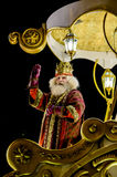 Figure of Melchior during parade. Melchior, one of the three Magi, seen here in a golden carriage during the Christmas Epiphany parade in Madrid Royalty Free Stock Photo