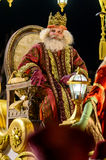 Figure of Melchior during parade. Melchior, one of the three Magi, seen here sitting  in a golden carriage during the Christmas Epiphany parade in Madrid Royalty Free Stock Photos