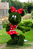 Figure of a mickey mouse made of grass. Landscape design stock photo