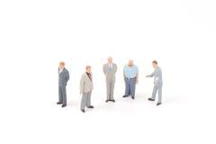 Figure miniatura dell'uomo di affari fotografie stock