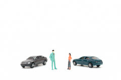 Figure miniatura della gente e dell'automobile Fotografia Stock Libera da Diritti