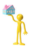 Figure with Miniature House Royalty Free Stock Photos