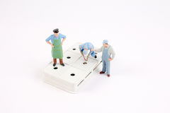 The figure of miniature woker Royalty Free Stock Images