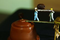 Figure model scene. Miniature construction worker figure model carrying coffee bean represent coffee and beverage concept related background Stock Photos