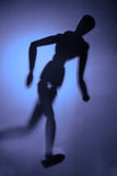 Figure in motion. Blurry silhouette of a figure in motion Royalty Free Stock Image